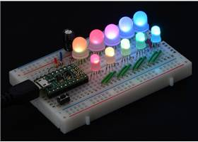 A chain of addressable RGB LEDs (#2535 and #2536) on a breadboard, controlled by an A-Star 32U4 Micro
