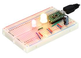 Two addressable RGB LEDs (#2535 and #2536) on a breadboard, controlled by an A-Star 32U4 Micro