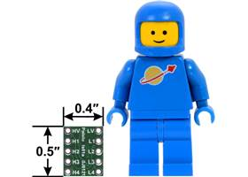 Logic level shifter, 4-channel, bidirectional, bottom view with dimensions next to a LEGO Minifigure for size reference