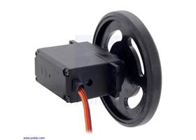 Black Futaba servo wheel mounted on a FEETECH FS5106R continuous rotation servo.