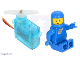 FEETECH FS0403 Sub-Micro Servo with a LEGO Minifigure as a size reference.