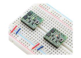 Mini Pushbutton Power Switches in a breadboard (SV version on left and LV version on right)