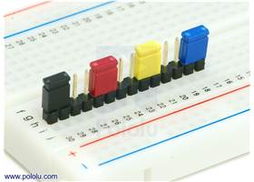 "0.100"" (2.54 mm) shorting blocks of assorted colors on a 0.1"" header strip"