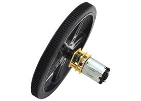 Black Pololu 70×8mm wheel on a Pololu micro metal gearmotor.