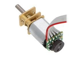 Magnetic Encoder on a Micro Metal Gearmotor with Extended Motor Shaft, assembled with ribbon cable wires.