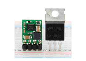 Pololu step-down voltage regulator D24V5Fx next to a 7805 voltage regulator in TO-220 package